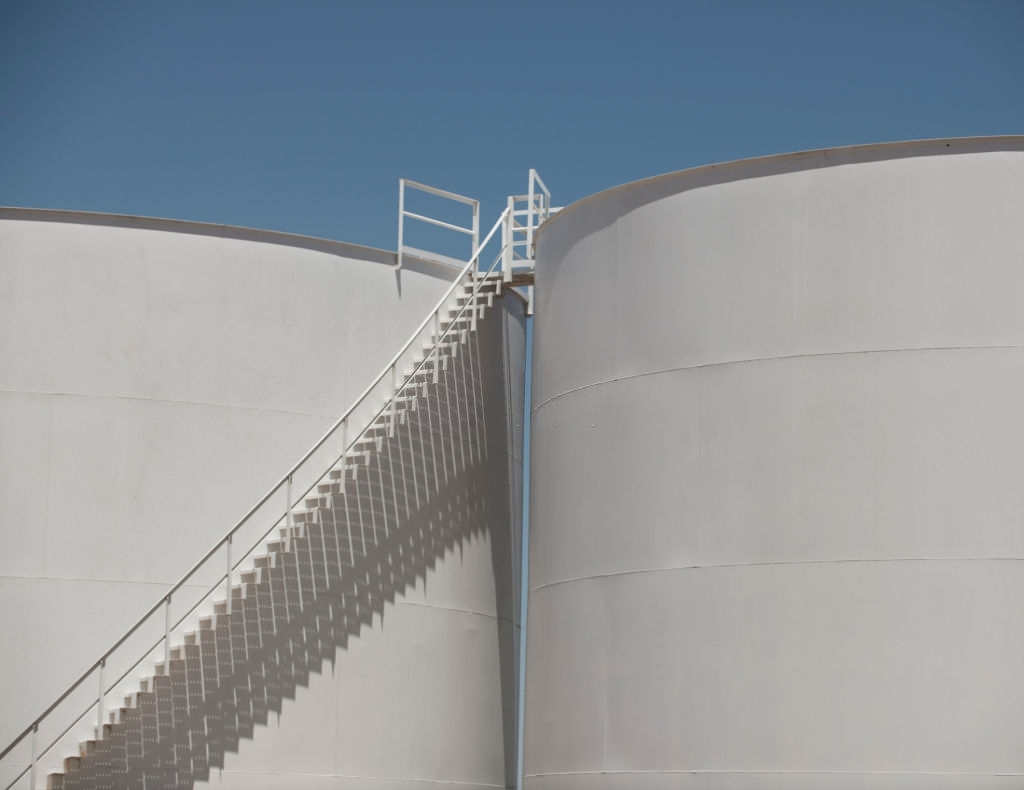 Detailed profile of a grain silo and elongated shadows beneath the stairs.